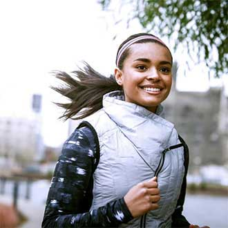 remington instagram woman running in warm vest