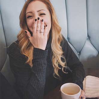remington instagram woman laughing with coffee cup