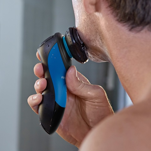 young man shaving his face with the Hyperflex Advanced Rotary Shaver XR1450