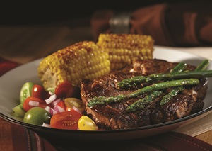 Ribeye steaks and roasted corn